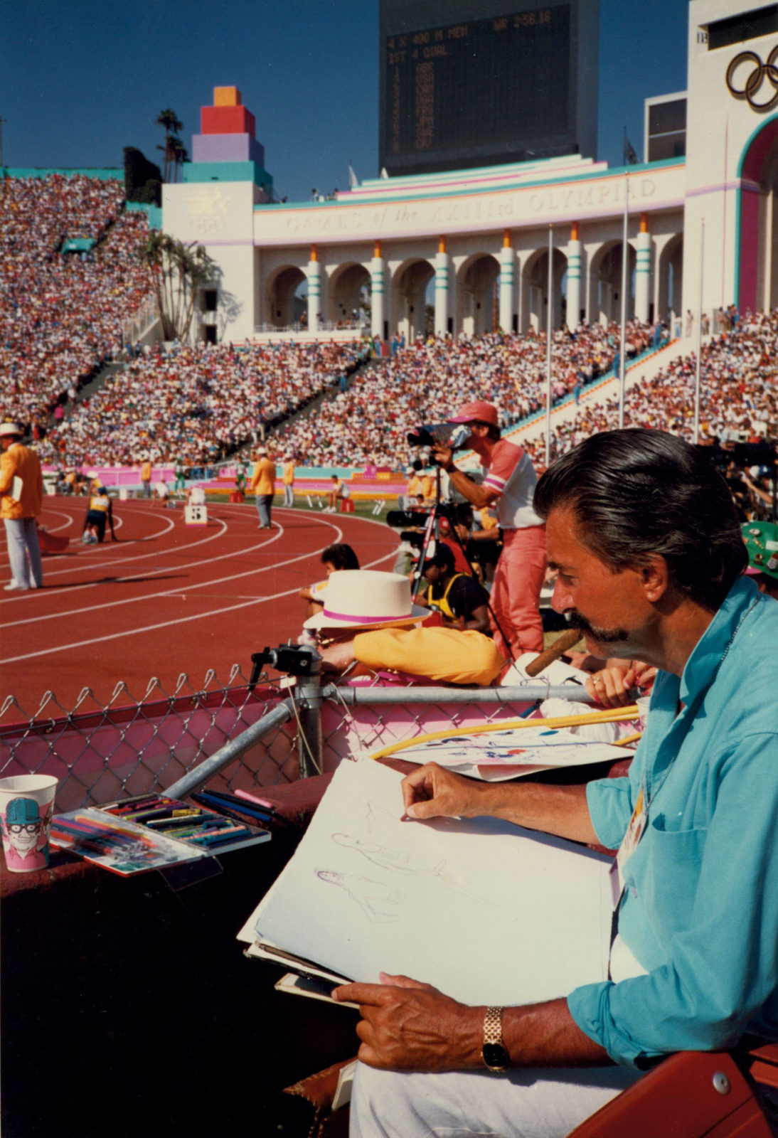 LeRoy Neiman sketching at the 1984 Olympics